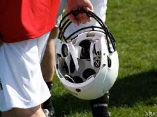 Player holding Xenith X1 helmet (2)
